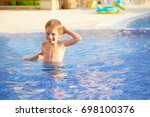 boy in the pool | Shutterstock . vector #698100376