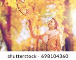season and people concept  ... | Shutterstock . vector #698104360