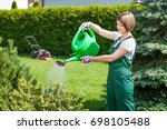 young woman watering in the... | Shutterstock . vector #698105488