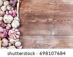 garlic. garlic cloves and... | Shutterstock . vector #698107684
