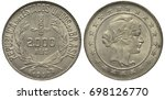 Small photo of Brazil Brazilian silver coin 2000 two thousand reis 1930, fascine above value tobacco leaves at sides, date below, liberty head within inner circle surrounded by stars