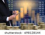 business man on digital stock... | Shutterstock . vector #698128144