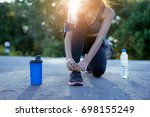 young girl asian knelt down to... | Shutterstock . vector #698155249