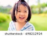 happy little asian girl having... | Shutterstock . vector #698212924
