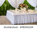 decorated and served party... | Shutterstock . vector #698246104