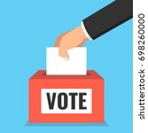 voting concept. hand putting... | Shutterstock .eps vector #698260000