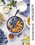 granola with natural yogurt ... | Shutterstock . vector #698260879