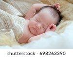 nice newborn baby boy lying in... | Shutterstock . vector #698263390