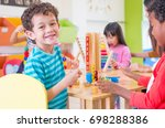 kindergarten students smile... | Shutterstock . vector #698288386