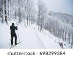 cross country skier in winter... | Shutterstock . vector #698299384