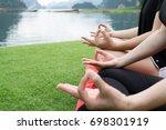 young girl doing yoga fitness...   Shutterstock . vector #698301919