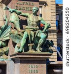 Small photo of Zurich, Switzerland - 20 July, 2016: fountain at the base of the monument to Alfred Escher on Bahnhofplatz square. Alfred Escher was a renowned Swiss politician, businessman and railway pioneer.