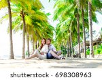 tropic beach wedding | Shutterstock . vector #698308963