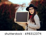 surprised student holding a... | Shutterstock . vector #698312374