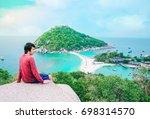 a man standing on top mountain...   Shutterstock . vector #698314570