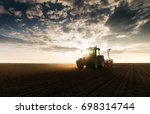 farmer with tractor seeding  ... | Shutterstock . vector #698314744
