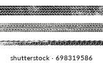 grunge tire track silhouette... | Shutterstock .eps vector #698319586