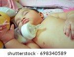 little asian girl is full of... | Shutterstock . vector #698340589