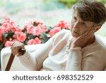 sad elder lady sitting on the...   Shutterstock . vector #698352529