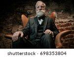 well dressed senior man in... | Shutterstock . vector #698353804