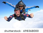 Small photo of Skydiving. Tandem passenger is very happy.