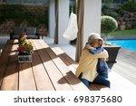 granddaughter and grandmother... | Shutterstock . vector #698375680