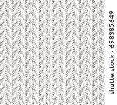 white knit fabric. herringbone... | Shutterstock .eps vector #698385649