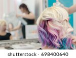 hairdresser spraying hair spray ... | Shutterstock . vector #698400640