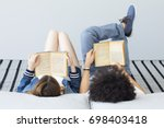 young people reading book | Shutterstock . vector #698403418