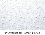 Water Droplets On A Gray...