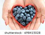 loving healthy fruits  woman... | Shutterstock . vector #698415028