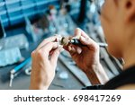 the girl works on a jewelry in... | Shutterstock . vector #698417269
