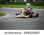 go kart driver on the circuit... | Shutterstock . vector #698420083