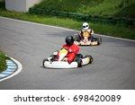 go kart driver on the circuit... | Shutterstock . vector #698420089