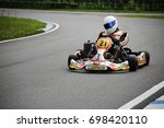 go kart driver on the circuit... | Shutterstock . vector #698420110