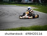 go kart driver on the circuit... | Shutterstock . vector #698420116