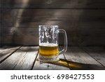 craft beer. a half drunk glass...   Shutterstock . vector #698427553