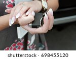 female with manicured nails... | Shutterstock . vector #698455120
