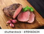 baked meat  garlic and basil on ... | Shutterstock . vector #698460634