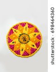 Stock photo flower rangoli for diwali or pongal made using marigold or zendu flowers and red rose petals over 698464360
