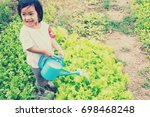 watering the vegetable garden  | Shutterstock . vector #698468248