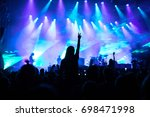crowd raising hands in the air... | Shutterstock . vector #698471998