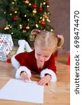 siblings writing a christmas... | Shutterstock . vector #698474470