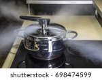 pressure cooker releasing hot... | Shutterstock . vector #698474599