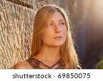 young woman outdoors at sunset | Shutterstock . vector #69850075