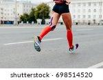 woman running city marathon in... | Shutterstock . vector #698514520
