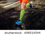feet athlete man in compression ... | Shutterstock . vector #698514544