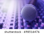 Close up of microphone on sound mixer background - stock photo