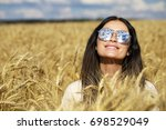 portrait of a young woman in... | Shutterstock . vector #698529049