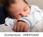 one week old newborn baby boy... | Shutterstock . vector #698551660